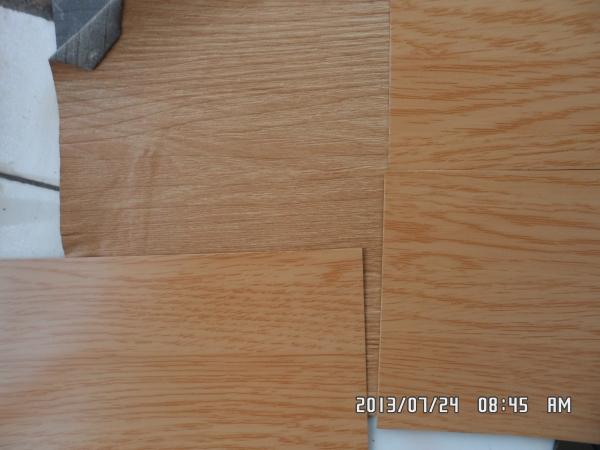 辊涂仿木纹铝塑板起初是用来代替原有岗纹铝塑板即表